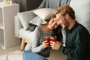 Couple drinking delicious mulled wine at home