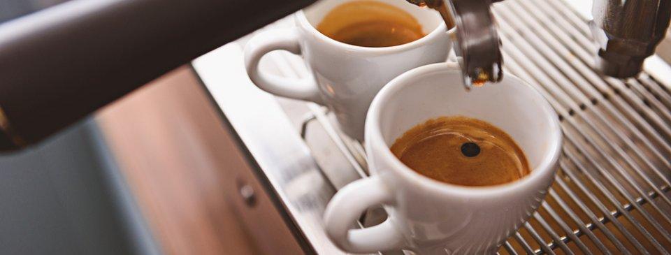 espresso machine and coffee cups